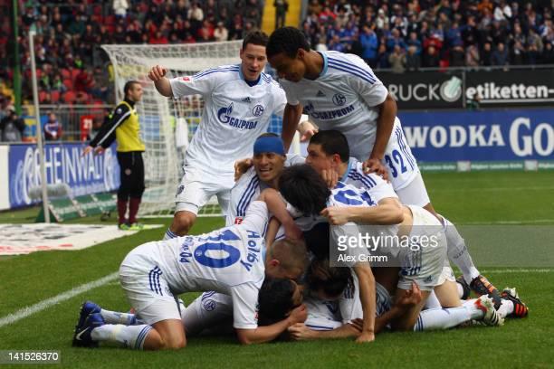 Raul of Schalke celebrates his team's third goal with team mates during the Bundesliga match between 1 FC Kaiserslautern and FC Schalke 04 at...