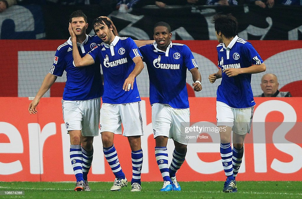 Raul (2nd L) of Schalke celebrates with his team mates after scoring his team's third goal during the Bundesliga match between FC Schalke 04 and FC St. Pauli at Veltins Arena on November 5, 2010 in Gelsenkirchen, Germany.