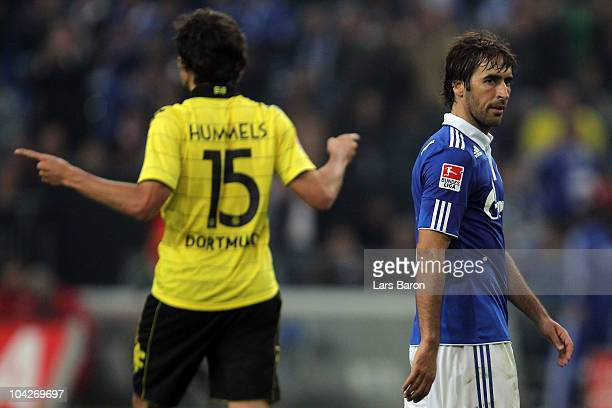 Raul of Schalke looks dejected next to Mats Hummels of Dortmund after loosing the Bundesliga match between FC Schalke 04 and Borussia Dortmund at...