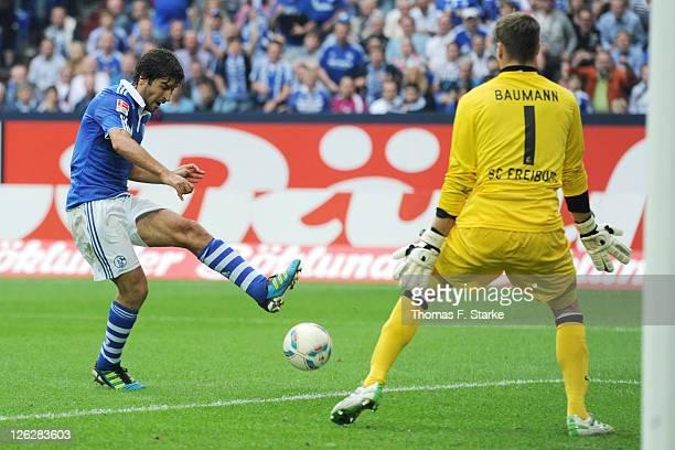 Raul of Schalke scores his teams fourth goal against Oliver Baumann of Freiburg during the Bundesliga match between FC Schalke 04 and SC Freiburg at...