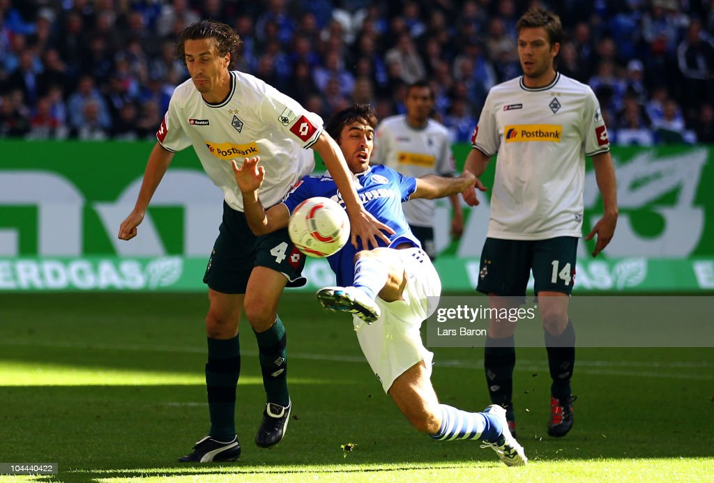 Raul of Schalke shoots on goal next to Roel Brouwers of Moenchengladbach during the Bundesliga match between FC Schalke 04 and Borussia...
