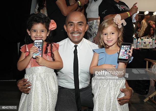 Raul Penaranda poses backstage with models at Kia STYLE360 Hosts Raul Penaranda Spring 2017 Momentum Fashion Show on September 13 2016 in New York...