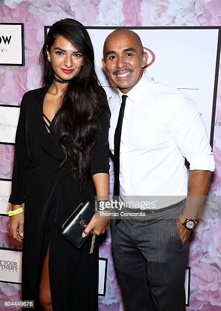 Raul Penaranda poses with a guest at Kia STYLE360 Hosts Raul Penaranda Spring 2017 Momentum Fashion Show on September 13 2016 in New York City