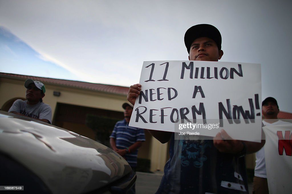 Raul Pop holds a sign reading '11 million need a reform now!' as he and others participate in a rally calling on President Barack Obama to immediately suspend deportations and for Congress to pass an immigration reform that's inclusive of all 11 million undocumented people in the U.S. on May 11, 2013 in Homestead, Florida. The rally is part of what is being called a rolling fast in different places throughout the nation over the course of the next two months to bring what organizers say is a moral, prophetic voice to the immigration debate.