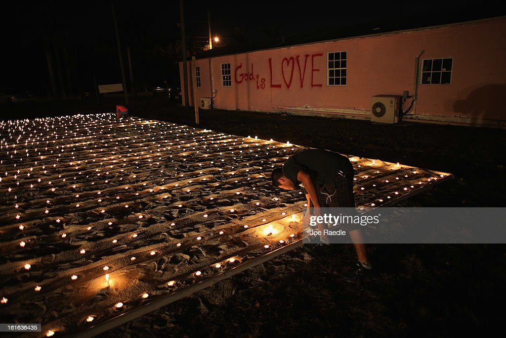 Raul Pop lights candles during a vigil at the Branches United Methodist Church to express hope for just and inclusive immigration reform as the United States government works on creating new policies towards immigrants on February 13, 2013 in Florida City, Florida. The vigil included the lighting of 1,120 candles symbolizing the number of people who the organizers say are deported from the United States each day.