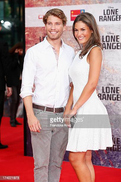 Raul Richter and Samira attend 'Lone Ranger' Berlin Premiere at Sony Centre on July 19 2013 in Berlin Germany