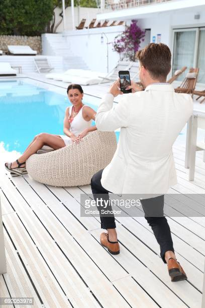 Raul Richter photographs his girlfriend Jessy during the Zhero hotel and 'Bahia Mediterraneo' restaurant opening on June 3 2017 in Palma de Mallorca...