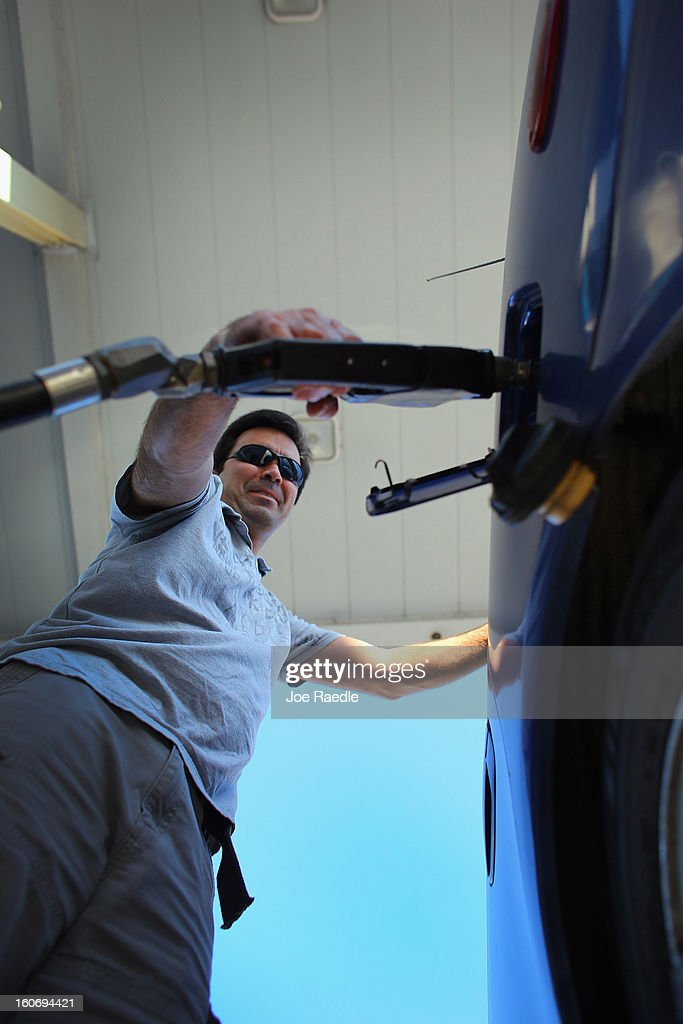 Raul Rivero uses a gas station's pump to fill his vehicle with gas on February 4, 2013 in Miami, Florida. Reports indicate that gas pump prices are at their highest level on record for this period of the year and may be an indication that the year ahead may see even higher records.