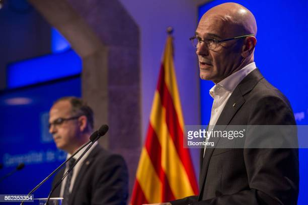 Raul Romeva Catalonia's head of foreign affairs right speaks as Jordi Turull Catalan government spokesman looks on during a news conference in...