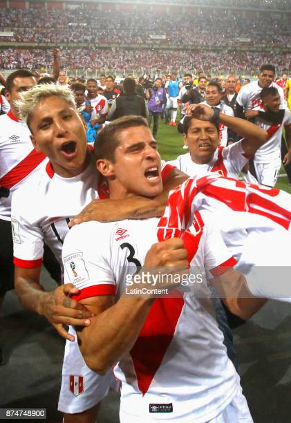Raul Ruidiaz and Aldo Corzo of Peru celebrate their victory and qualification to the World Cup after a second leg match between Peru and New Zealand...