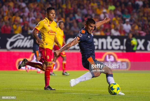 Raul Ruidiaz of Morelia and Carlos Salcido of Chivas fight for the ball during the 12th round match between Morelia and Guadalajara as part of the...