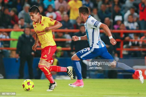 Raul Ruidiaz of Morelia and Emmanuel Garcia of Pachuca fight for the ball during the 10th round match between Pachuca and Morelia as part of the...