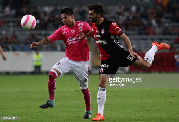 Raul Ruidiaz of Morelia and Facundo Erpen of Atlas fight for the ball during the 10th round match between Atlas and Morelia as part of the Torneo...