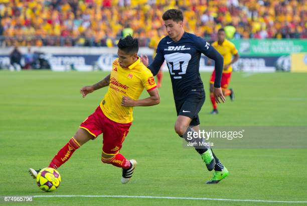 Raul Ruidiaz of Morelia and Josecarlos Van Rankin of Pumas fight for the ball during the 16th round match between Morelia and Pumas as part of the...