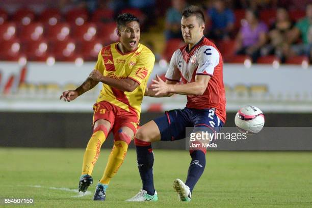 Raul Ruidiaz of Morelia and Kristian Alvarez of Veracruzfight for the ball during the 11th round match between Veracruz and Morelia as part of the...