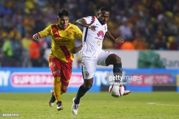 Raul Ruidiaz of Morelia and William Da Silva of America fight for the ball during the seventh round match between Morelia and America as part of the...
