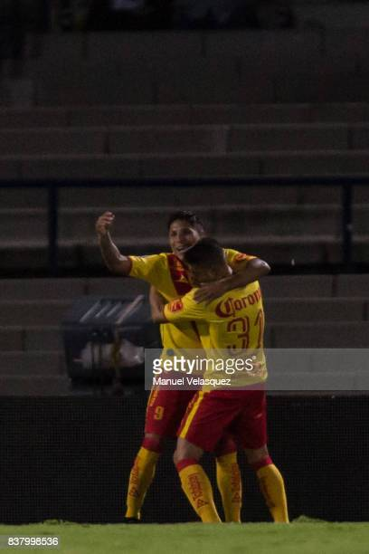 Raul Ruidiaz of Morelia celebrates with Gaston Lezcano of Morelia after scoring the first goal of his team during the 6th round match between Pumas...