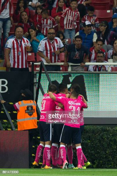 Raul Ruidiaz of Morelia celebrates with his teammates after scoring the first goal of his team during the 13th round match between Chivas and Morelia...
