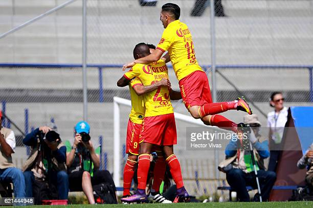 Raul Ruidiaz of Morelia celebrates with teammates after scoring the first goal of his team during the 16th round match between Pumas UNAM and Morelia...
