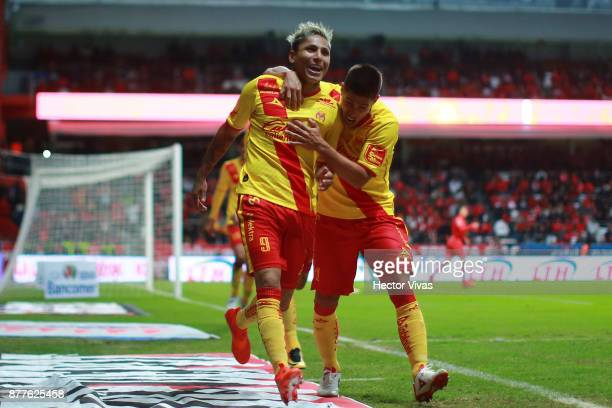 Raul Ruidiaz of Morelia celebrates with teammates after scoring the first goal of his team during a match between Toluca and Morelia as part of the...