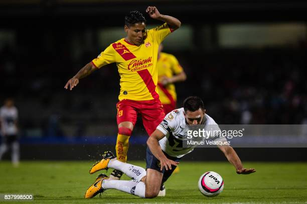 Raul Ruidiaz of Morelia fights for the ball against Luis Quintana of Pumas during the 6th round match between Pumas UNAM and Morelia as part of the...