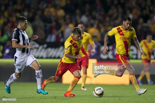 Raul Ruidiaz of Morelia fights for the ball with CelsoOrtiz of Monterrey during the semifinal first leg match between Morelia and Monterrey as part...