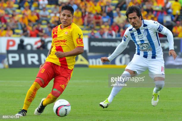 Raul Ruidiaz of Morelia plays the ball followed by Jorge Hernandez of Pachuca during the fifth round match between Morelia and Pachuca as part of the...