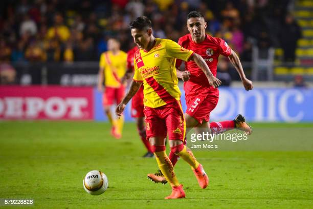 Raul Ruidiaz of Morelia runs with the ball while followed by Santiago Garcia of Toluca during the quarter finals second leg match between Morelia and...