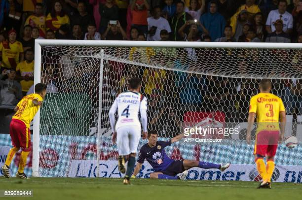 Raul Ruidiaz of Morelia scores a penalty during the match against America during their Mexican Apertura tournament football match at the Morelos...