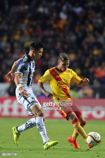 Raul Ruidiaz of Morelia vies for the ball with Jesus Molina of Monterrey during their Mexican Apertura tournament fisrt leg semifinal football match...