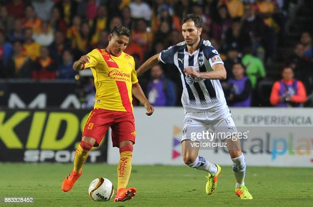 Raul Ruidiaz of Morelia vies for the ball with Jose Basanta of Monterrey during their Mexican Apertura tournament first leg semifinal football match...