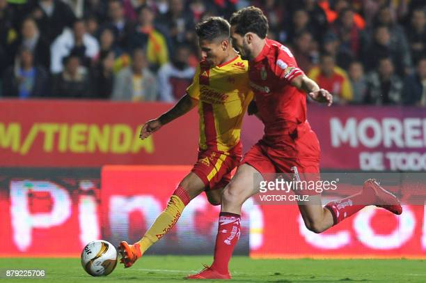 Raul Ruidiaz of Morelia vies for the ball with Santiago Garcia of Toluca during their querter final Mexican Apertura tournament football match at the...