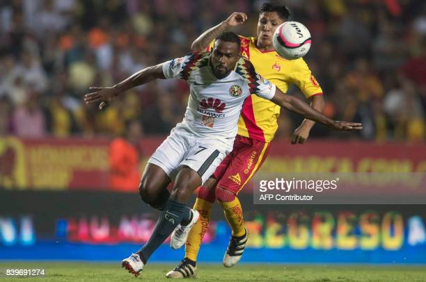 Raul Ruidiaz of Morelia vies for the ball with William Da Silva of America during their Mexican Apertura tournament football match at the Morelos...
