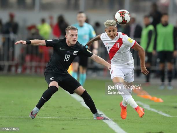 Raul Ruidiaz of Peru and Kip Colvey of New Zealand compete for the ball during a second leg match between Peru and New Zealand as part of the 2018...