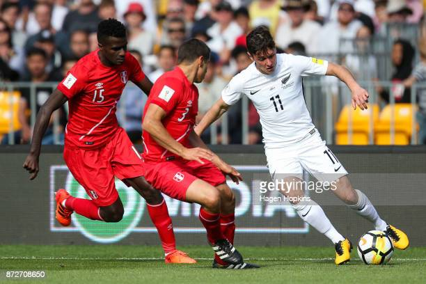 Raul Ruidiaz of Peru attempts to evade Christian Ramos and Aldo Corzo of Peru during the 2018 FIFA World Cup Qualifier match between the New Zealand...