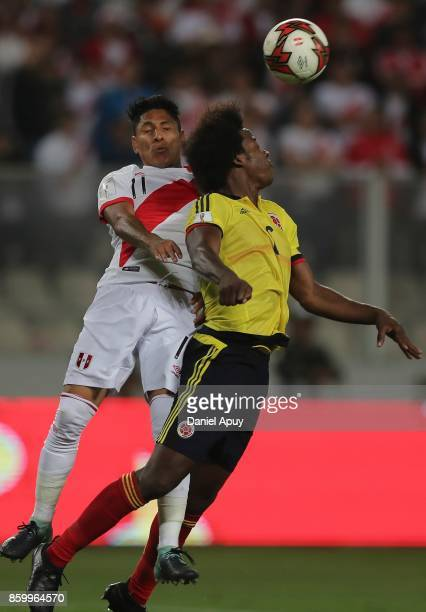 Raul Ruidiaz of Peru goes for a header with Carlos Sanchez of Colombia during a match between Peru and Colombia as part of FIFA 2018 World Cup...