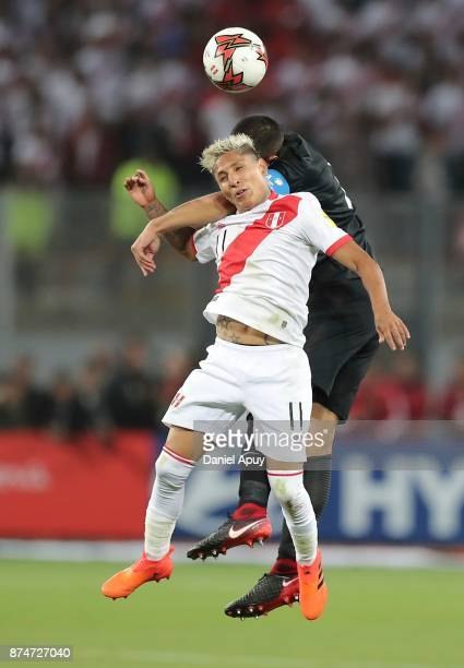 Raul Ruidiaz of Peru goes for a header with Winston Reid of Nwe Zealand during a second leg match between Peru and New Zealand as part of the 2018...