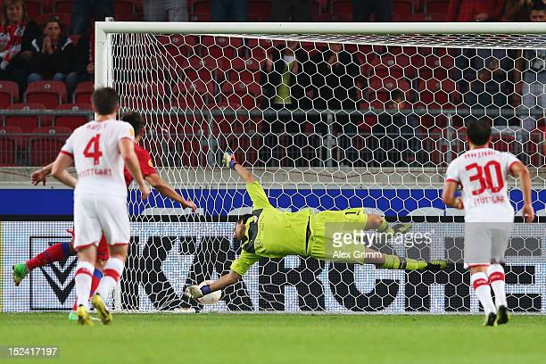 Raul Rusescu of Bucuresti scores his team's second goal with a penalty against goalkeeper Sven Ulreich of Stuttgart during the UEFA Europa League...