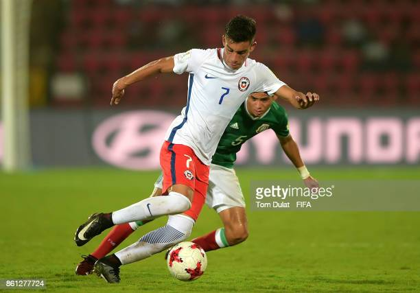 Raul Sandoval of Mexico and Ignacio Contreras of Chile in action during the FIFA U17 World Cup India 2017 group E match between Mexico and Chile at...