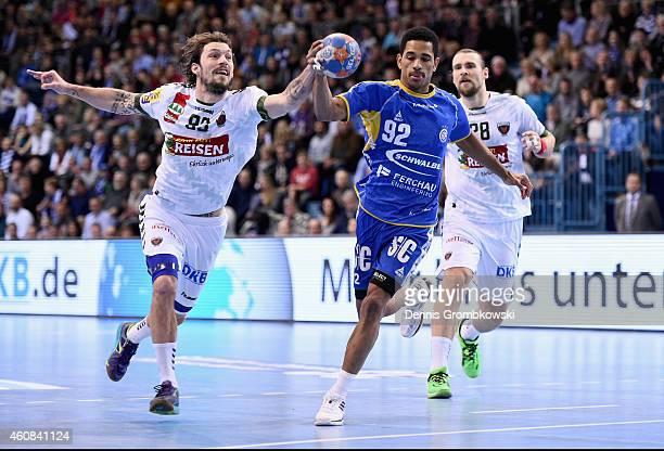 Raul Santos of VfL Gummersbach is challenged by Fredrik Raahauge Petersen of Fuechse Berlin during the DKB Handball Bundesliga match between VfL...