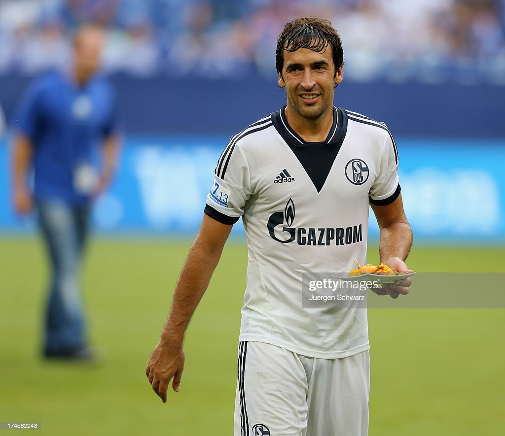 Raul serves spanish food to team-mates after his farewell match between Schalke 04 and Al-Sadd Sports Club Katar at Veltins Arena on July 27, 2013 in Gelsenkirchen, Germany.