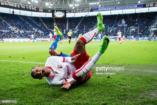 Raul Silva of Braga is tackled by Kerem Demirbay of Hoffenheim during the UEFA Europa League Group C match between 1899 Hoffenheim and Sporting Braga...