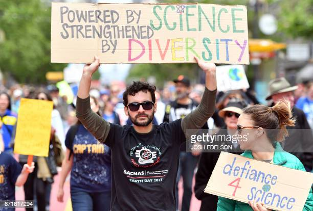 Raul Tores holds up a sign during the March for Science in San Francisco California on April 22 2017 Thousands of people joined a global March for...