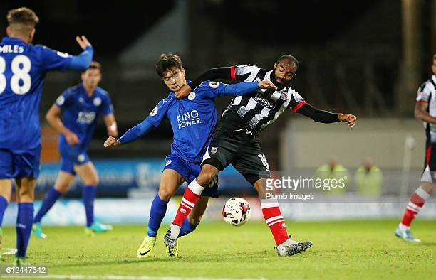 Raul Uche of Leicester City in action with Dominic Vose of Grimsby Town during the checkatrade Trophy match between Grimsby Town and Leicester City...