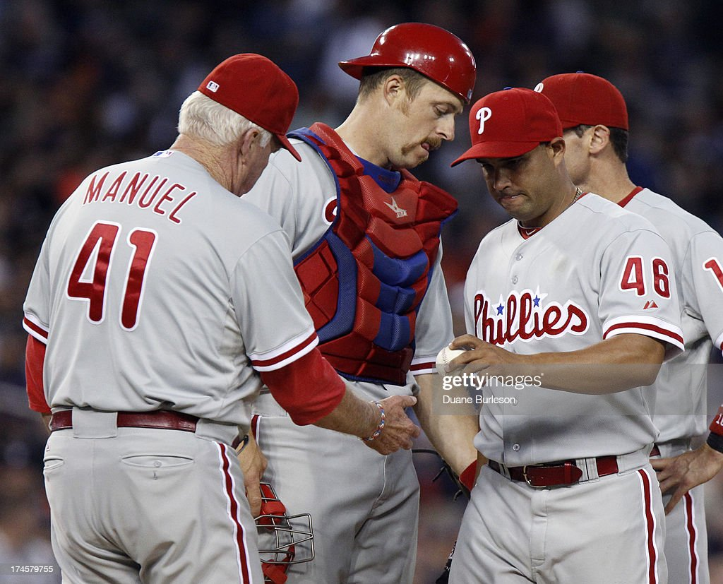 Raul Valdes #46 of the Philadelphia Phillies gives up the ball to manager <a gi-track='captionPersonalityLinkClicked' href=/galleries/search?phrase=Charlie+Manuel&family=editorial&specificpeople=217967 ng-click='$event.stopPropagation()'>Charlie Manuel</a> #41 with the Detroit Tigers leading 9-0 in the fourth inning at Comerica Park on July 27, 2013 in Detroit, Michigan.