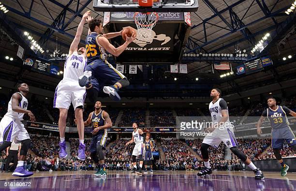 Raulzinho Neto of the Utah Jazz goes up for the shot against Kosta Koufos of the Sacramento Kings on March 13 2016 at Sleep Train Arena in Sacramento...