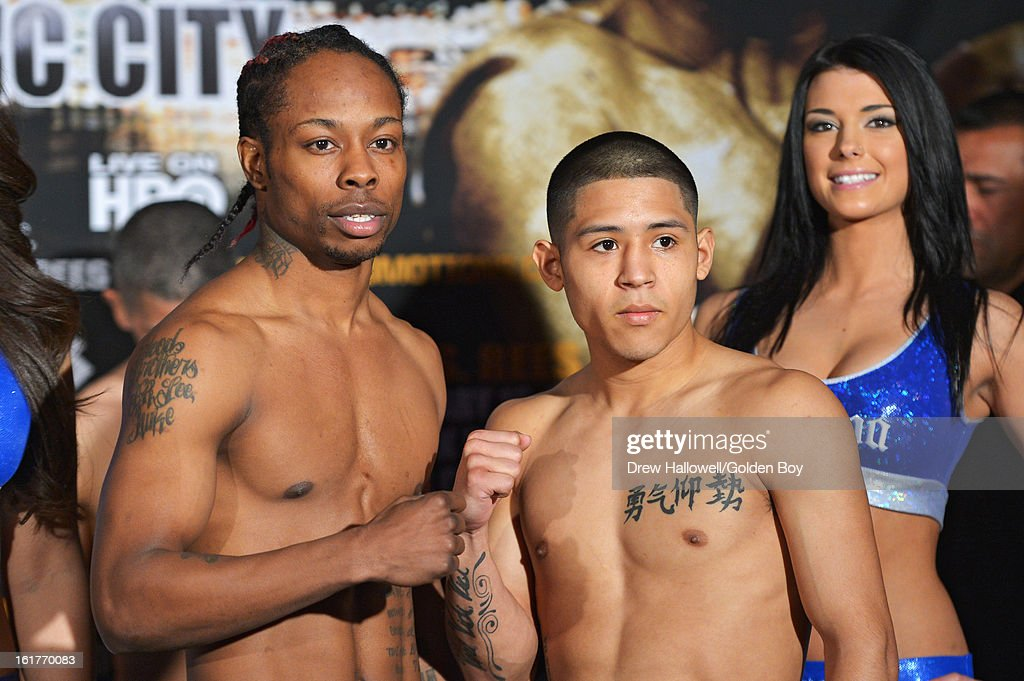 Rau'Shee Warren and Richard Hernandez pose for a photograph during weigh-in before the WBC Lightweight World Championship at Caesars Atlantic City on February 15, 2013 in Atlantic City, New Jersey.