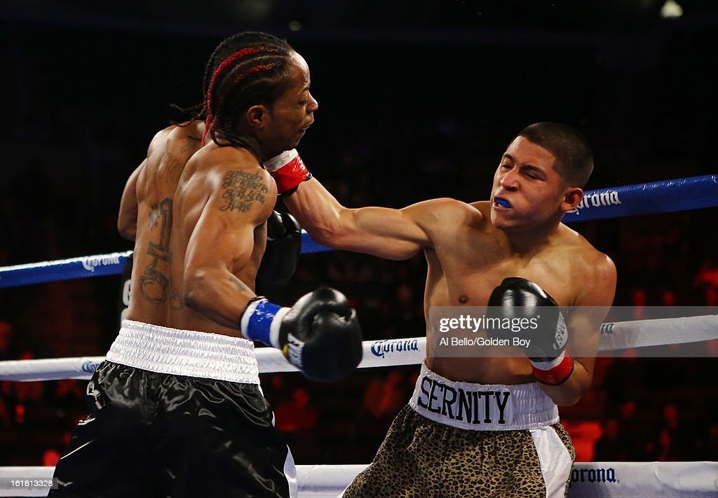 Rau'Shee Warren punches Richard Hernandez during their Bantamweight fight at Atlantic City Boardwalk Hall on February 16, 2013 in Atlantic City, New Jersey.