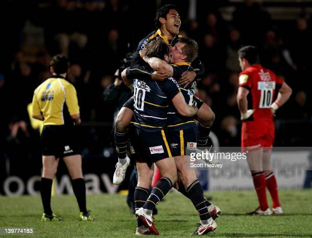 Ravai Fatiaki of Worcester celebrates with ANdy Goode and Jake Abbott after the final whistle during the Aviva Premiership match between Worcester...