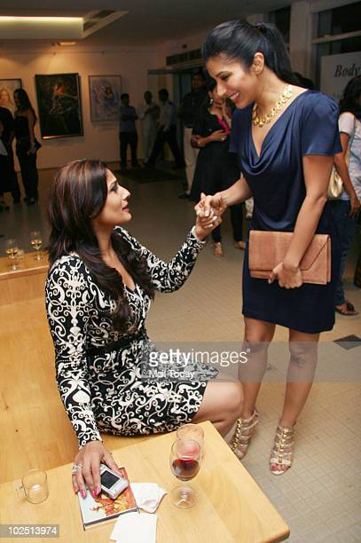 Raveena Tandon greets Sophie Chaudhary at the opening of an exhibition at The Museum Art Gallery in Mumbai on June 28 organised by Nawaz Modi...